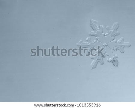 Macro photo of a beautiful snowflake close-up