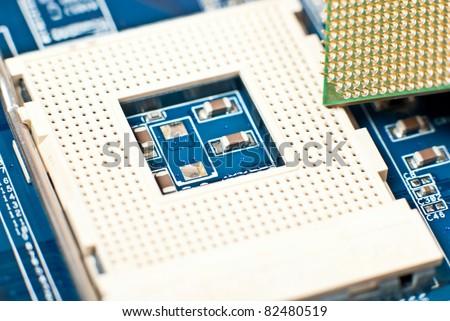 Macro photo of a computer motherboard. Digital components