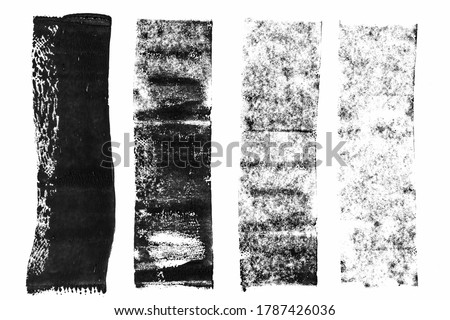 macro photo of black lino ink remain, linocutting paint roller texture on white paper background.  Сток-фото ©