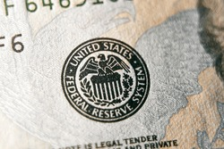 macro photo of federal reserve system symbol on hundred dollar bill. shallow focus. close-up with fine and sharp texture