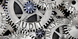 Macro photo of tooth wheel mechanism with AUDIT, ANALYSIS, REVIEW, DATA, REPORT, CLIENT and ASSET words imprinted on metal surface