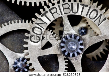 Macro photo of tooth wheel mechanism with CONTRIBUTION concept letters