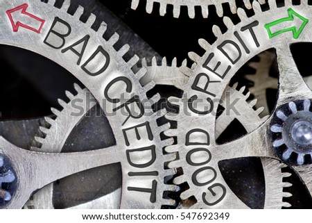 Macro photo of tooth wheel mechanism with imprinted arrows and BAD CREDIT, GOOD CREDIT concept words
