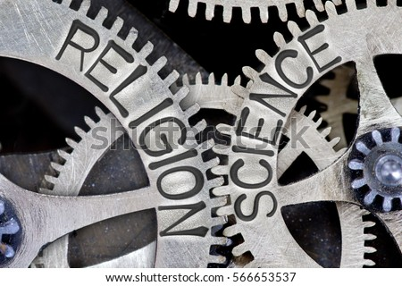 Macro photo of tooth wheel mechanism with imprinted RELIGION, SCIENCE concept words