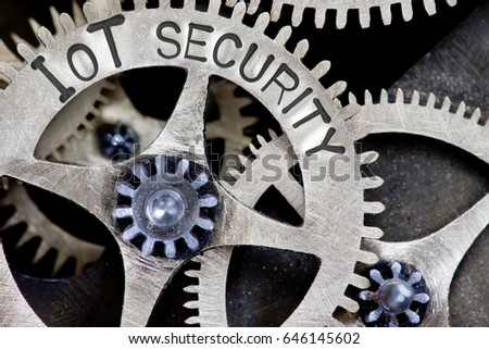 Macro photo of tooth wheel mechanism with IOT SECURITY letters imprinted on metal surface #646145602