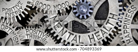 Macro photo of tooth wheel mechanism with MENTAL HEALTH, HAPPINESS, GOOD MOOD, POSITIVE THINKING, POSITIVE ENERGY and OPTIMISM letters imprinted on metal surface #704893369