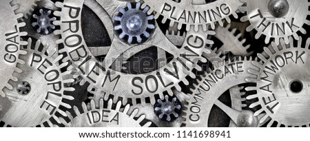 Macro photo of tooth wheel mechanism with PROBLEM SOLVING concept related words imprinted on metal surface