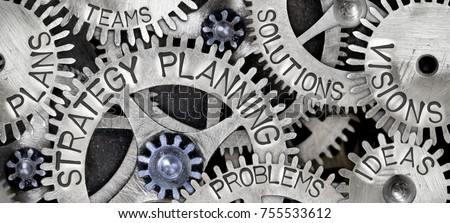 Macro photo of tooth wheel mechanism with STRATEGY PLANNING concept related words imprinted on metal surface #755533612