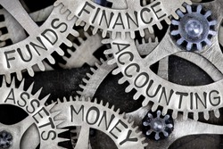 Macro photo of tooth wheels with ACCOUNTING, MONEY, FINANCE, ASSETS and FUNDS words imprinted on metal surface