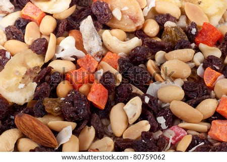 Macro photo of trail mix with peanuts, almonds, raisins, bananas and other natural foods