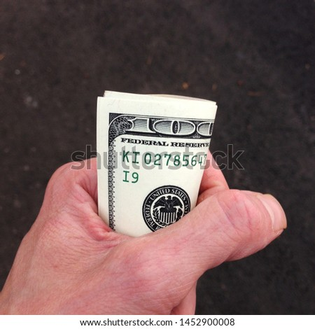 Macro photo of us dollars in hand. Texture background American bills money dollars in hand. Image of money 50 and 100 us dollars in hand