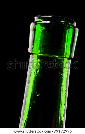 macro photo of wine bottle isolated on a black background - stock photo