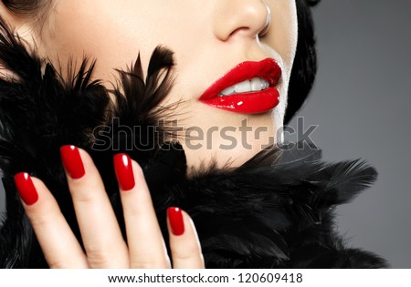 Macro photo of  woman with fashion red nails and sensual lips