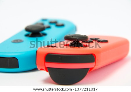 macro photo photography of a wireless console controller in different colors detail in high key