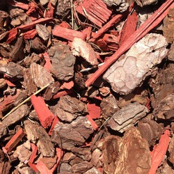 Macro photo pine wood bark nuggets. Image red brown wood bark chips texture background