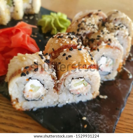 Macro photo sushi rolls with eel and ginger. Stock photo Asian food sushi set