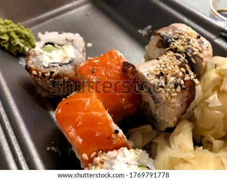 Macro photo sushi with salmon and eel. Stock photo food sushi with salmon and eel