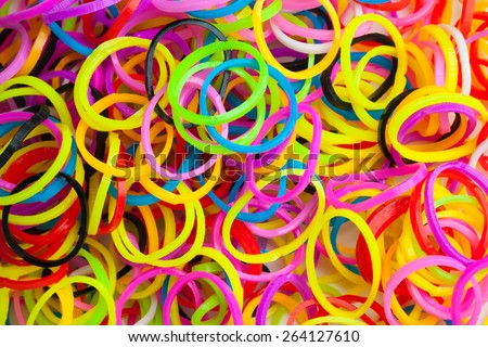 Macro photo texture of small round colorful rubber bands for making rainbow loom bracelets