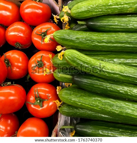 Macro photo tomato and cucumbers. Stock photo background red tomatoes and cucumbers vegetables