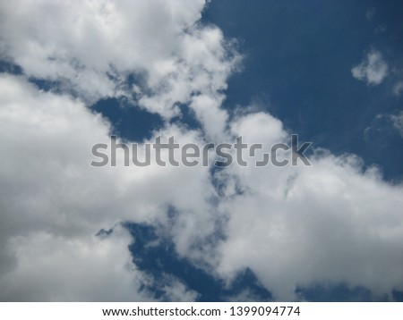 macro photo with a decorative background of blue sky and white clouds for decoration and design as a source for prints, posters, Wallpaper, advertising, decor
