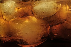 Macro photography of a drink with ice cubes