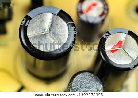 Macro photography of capacitors and other electronic components in an electronic board #1392376955