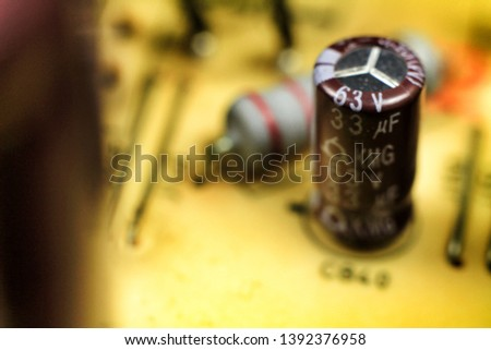 Macro photography of capacitors and other electronic components in an electronic board #1392376958