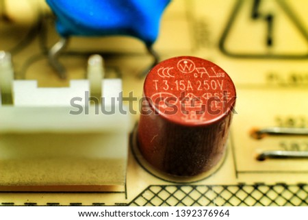 Macro photography of capacitors and other electronic components in an electronic board #1392376964