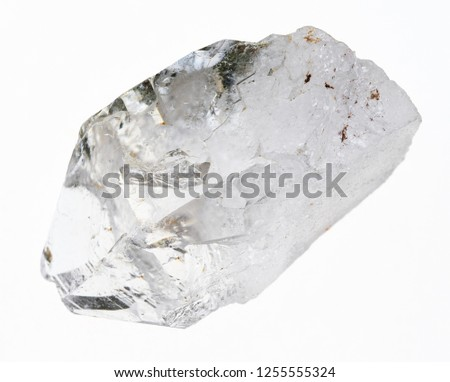 macro photography of natural mineral from geological collection - raw clear quartz (rock crystal) stone on white background