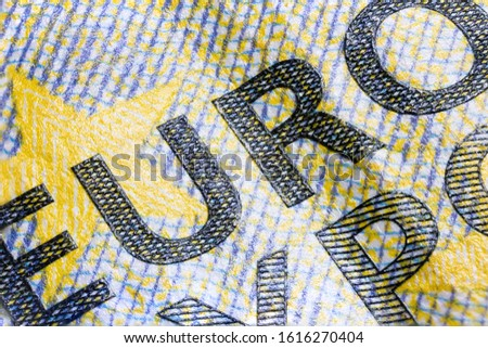 macro photography of the intaglio print on a five euro banknote, high resolution capture. Sharp detailed shot of the euro character on the ecb 5 euro note. the embossing of the print nicely to see. Stockfoto ©
