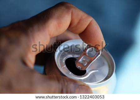 Macro pic male finger opening beverage can drink
