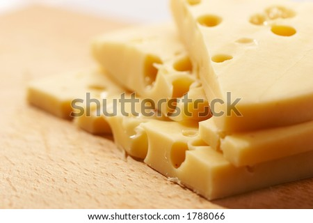 macro pic of Edam cheese on the wooden board
