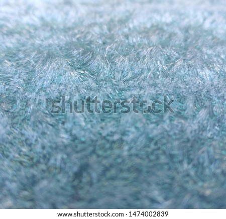 Macro picture of ice crystal formations on car bonnet