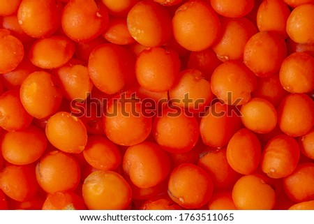 Photo of Macro picture of orange red lentils - a family of legumes, a source of protein. Food for vegetarians, gluten-free cereal. Proper nutrition.