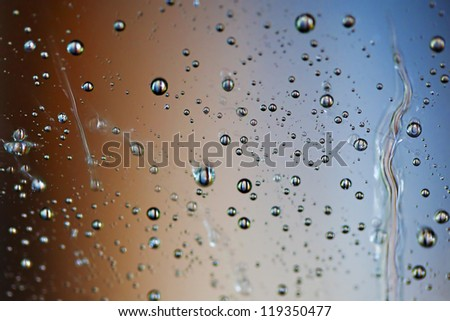 Macro picture of water droplets on window, shallow DOF