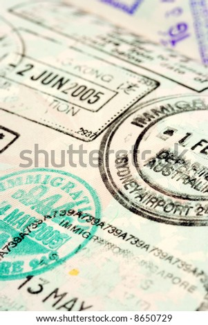 Macro / selective focus image of passport stamps.  Focus is in the middle.