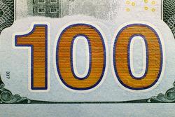 Macro shot (closeup ) of a new 100 dollar bill Series 2009 A. Big