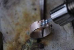Macro shot. Craft jewelery making with professional tools. A handmade jeweler process, manufacture of jewellery. Melting metal