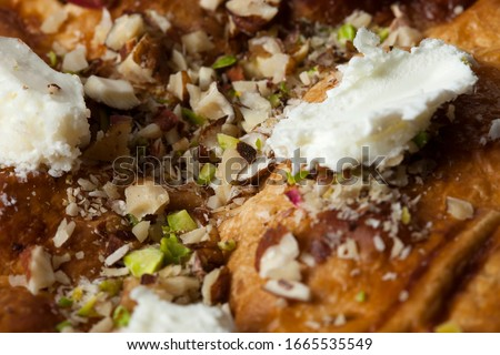 Macro shot is Egypt's famous and traditional dessert. It is called Om Ali, Umm Ali or Oum Ali. Egyptian Bread Pudding. Arabic cuisine, Egypt culture concepts. Horizontal close-up. Stock photo ©