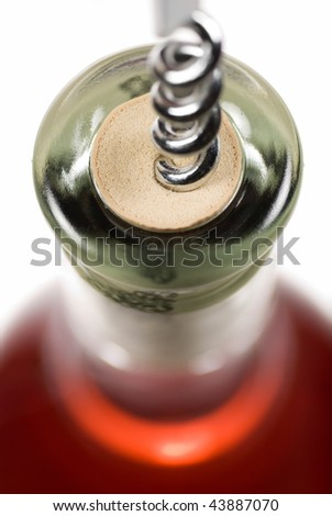 Macro shot of a bottle of red wine being opened