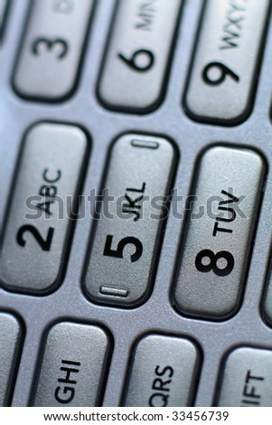 Macro shot of a cell phone number pad - stock photo