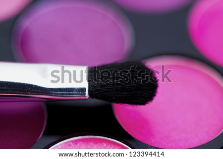 macro shot of a colorful palette of cosmetics