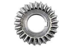 Macro shot of a damaged bevel gear with bevel teeth, isolated on a white background, top view.