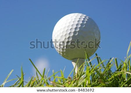 Macro shot of a golf ball against a beautiful blue sky