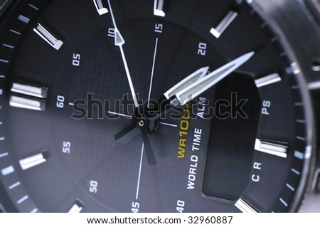 Macro shot of a modern high-tech solar energy wrist watch - stock photo