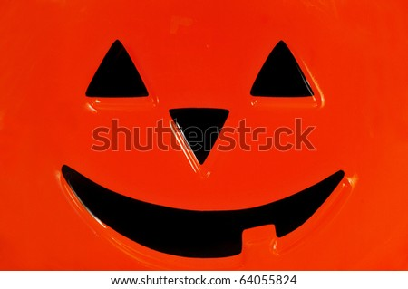 Macro shot of a pumpkin face decoration depicting halloween - stock photo