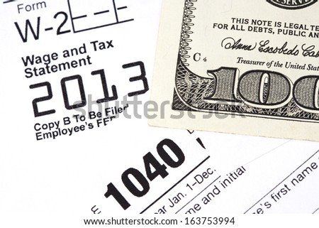 Macro shot of a W2 & 1040 form. - stock photo