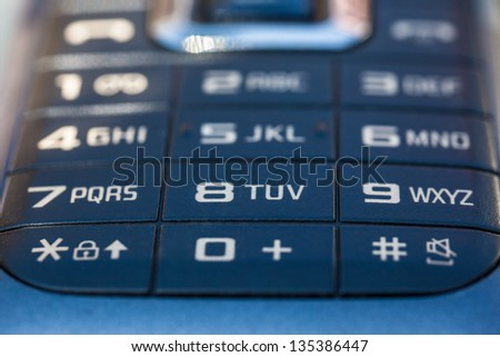 macro shot of an obsolete and blue mobile phone keypad