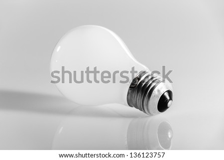 macro shot of an obsolete incandescence light bulb over a white background
