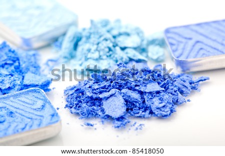 macro shot of  blue make-up eyeshadows